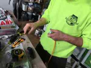 Sandro attaches the 3-scoket plugs to the special orange cord wiring.